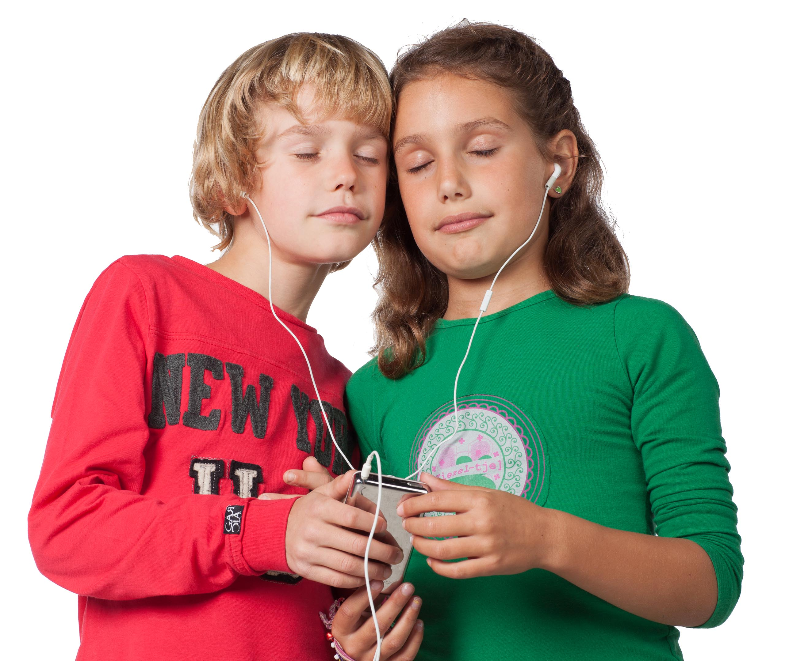 Boy and girl listening to music on the same device.