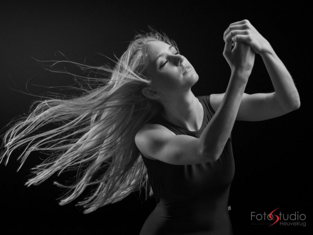 stupdiophoto of a femaledancer with eyes closed.