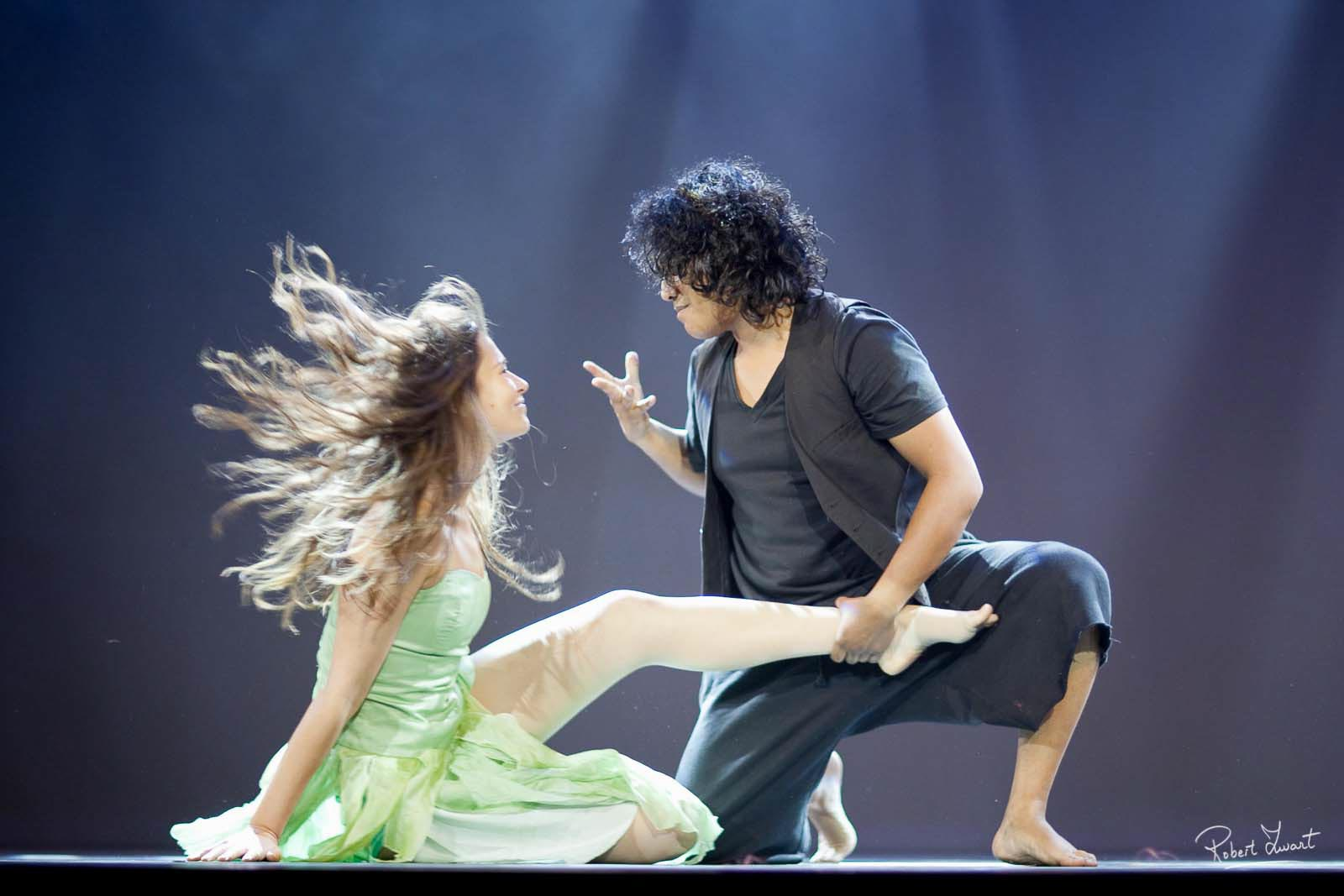Dynamic interaction between female and male dancer.