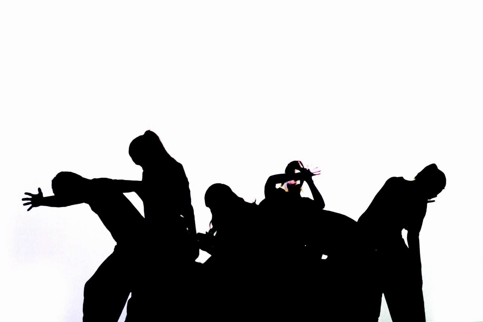 A group of dancers as a silhouette.