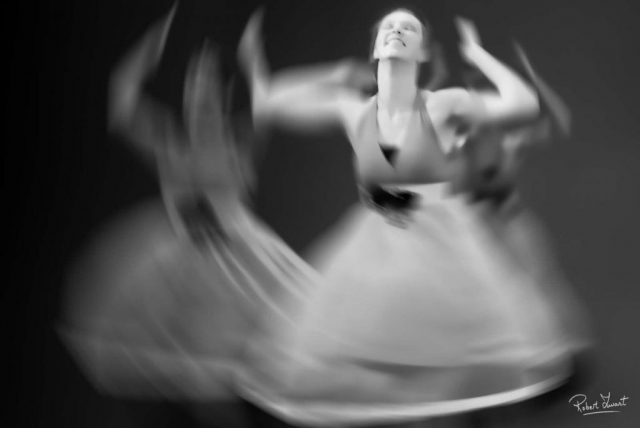 Femaledancer in black and white shot with a long shutterspeed.