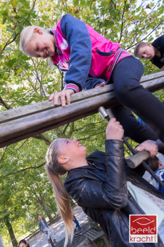 Girls climbing on a climbing frame