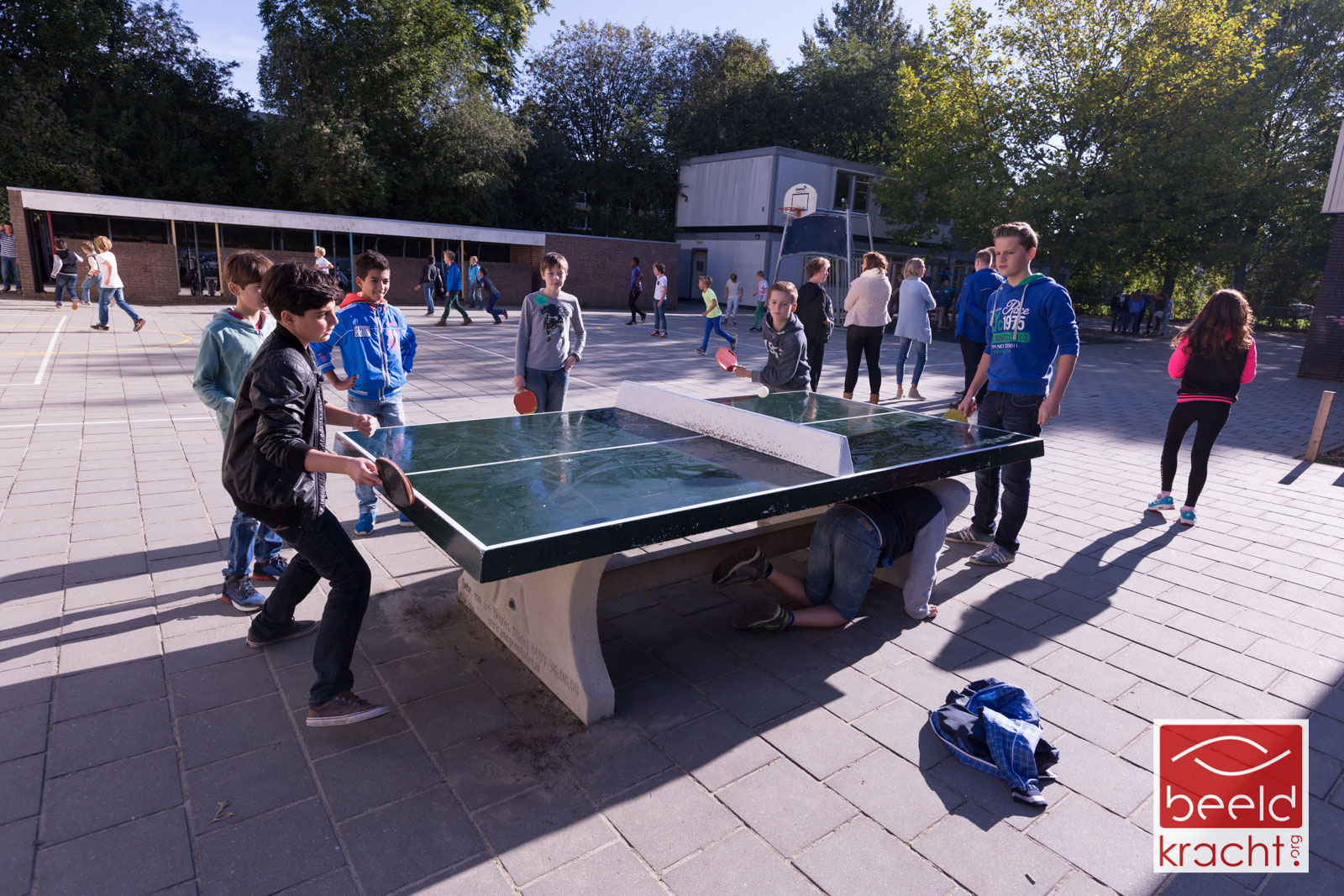 Two boys at school, playing tabletennis during the break.