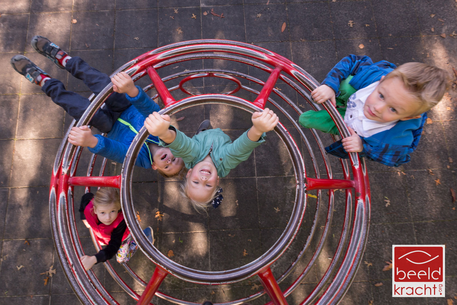 Children playing on a climbing frame from a bird perspective.