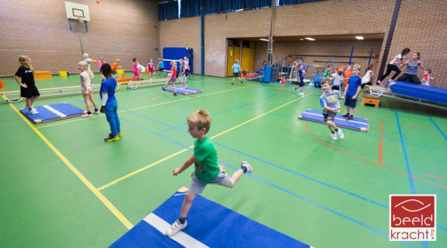 all children active in the sportshall of a primary school.