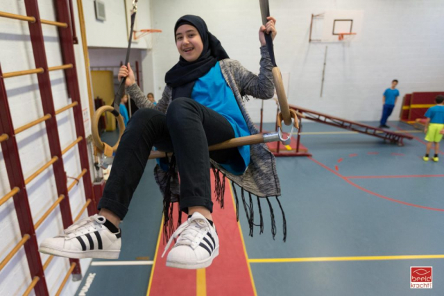 Young moroccan girl enjoying the sportslesson in school.