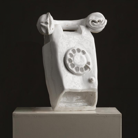 Strange phone artwork of porcelain with ear and mouth